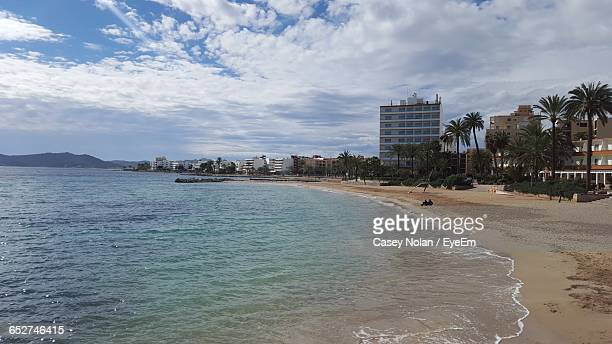 scenic view of beach against sky - casey nolan stock pictures, royalty-free photos & images