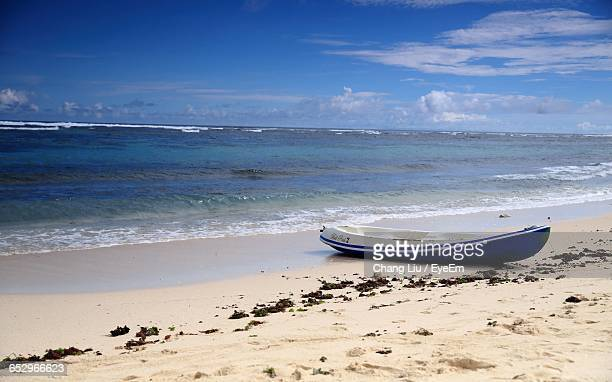 scenic view of beach against sky - liu he stock pictures, royalty-free photos & images