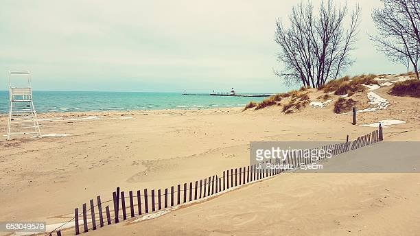 scenic view of beach against sky - saint joseph stock pictures, royalty-free photos & images