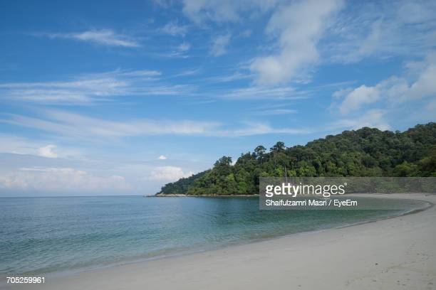 scenic view of beach against sky - shaifulzamri stock pictures, royalty-free photos & images