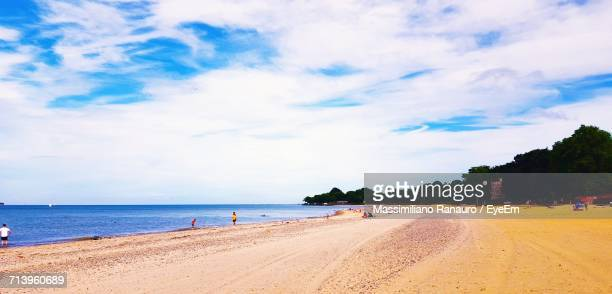 scenic view of beach against sky - massimiliano ranauro stock pictures, royalty-free photos & images