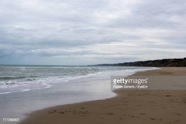 scenic view of beach against sky - omaha beach stock pictures, royalty-free photos & images