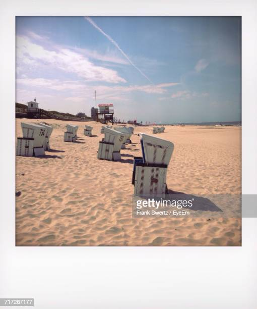 scenic view of beach against sky - frank swertz stock photos and pictures
