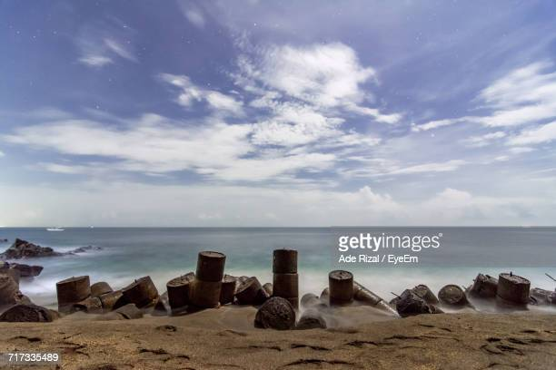 scenic view of beach against sky - ade rizal stock photos and pictures