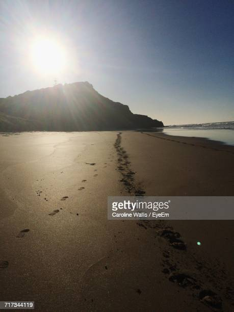 scenic view of beach against sky - gisborne stock photos and pictures