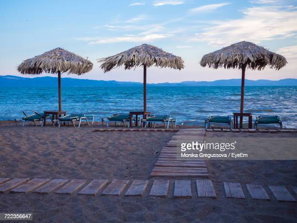 scenic view of beach against sky - monika gregussova stock pictures, royalty-free photos & images