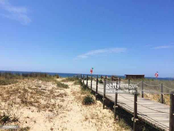 scenic view of beach against sky - alvor stock pictures, royalty-free photos & images