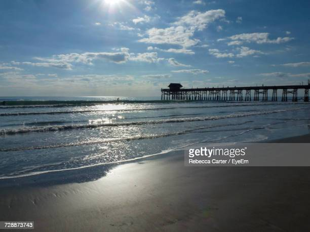 scenic view of beach against sky - cocoa beach stock pictures, royalty-free photos & images