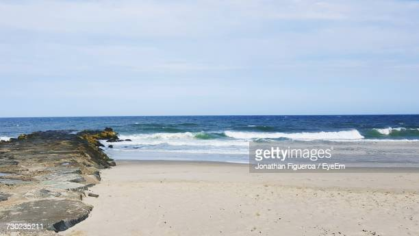scenic view of beach against sky - jonathan figueroa stock pictures, royalty-free photos & images