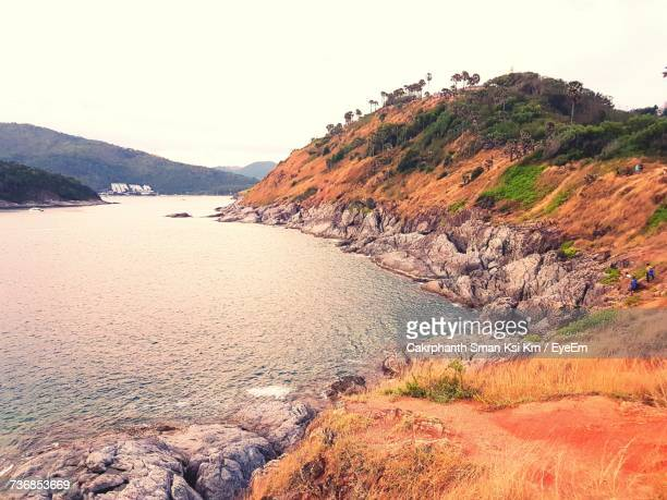 scenic view of beach against sky - ksi stock photos and pictures