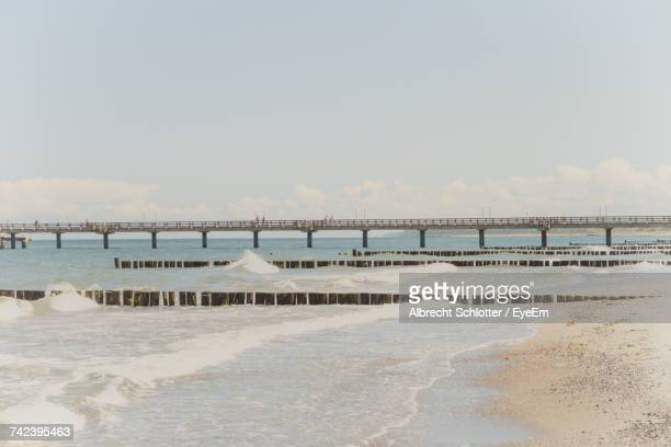 scenic view of beach against sky - albrecht schlotter foto e immagini stock
