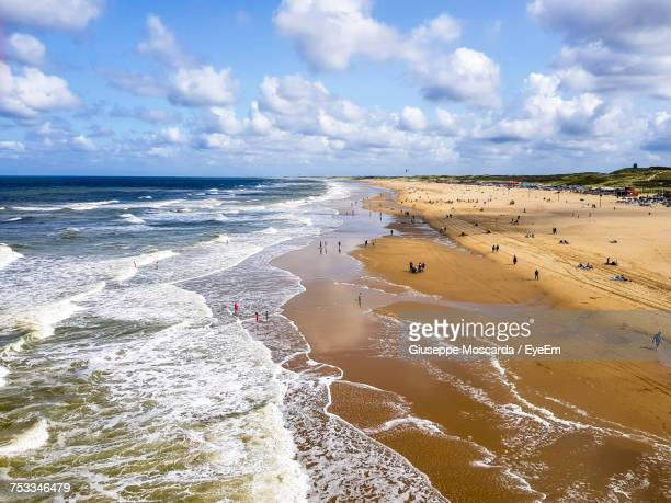 scenic view of beach against sky - scheveningen stock pictures, royalty-free photos & images