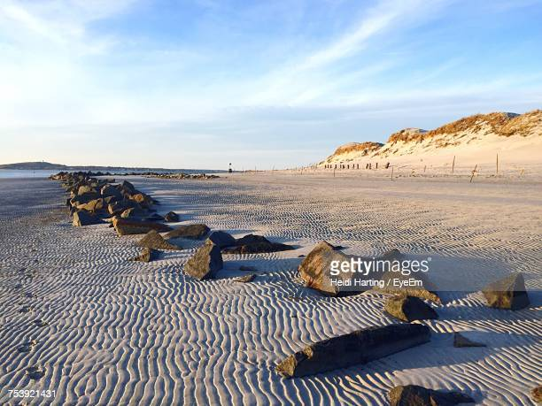 scenic view of beach against sky - plymouth massachusetts stock photos and pictures