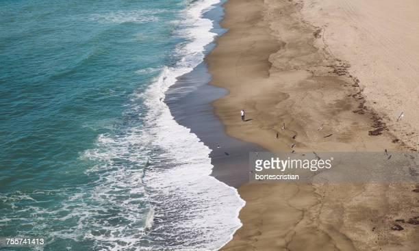 scenic view of beach against sky - bortes stock-fotos und bilder