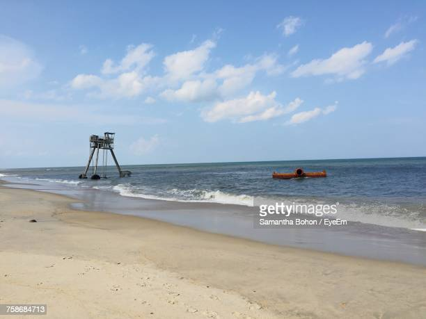 scenic view of beach against sky - kitty hawk beach stock pictures, royalty-free photos & images