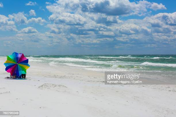 scenic view of beach against sky - destin beach stock pictures, royalty-free photos & images