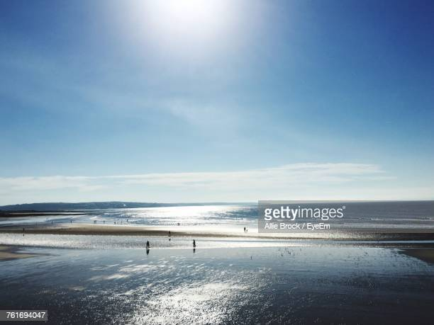 scenic view of beach against sky - porthcawl stock pictures, royalty-free photos & images