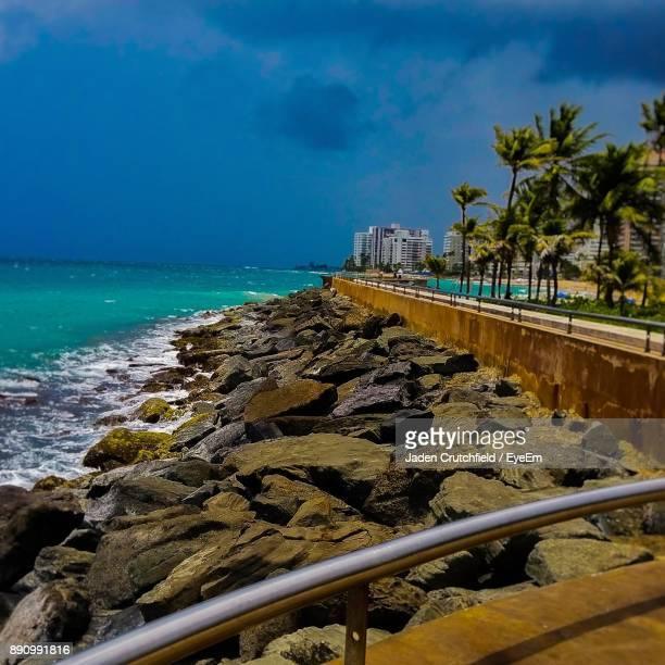 scenic view of beach against sky - san juan stock pictures, royalty-free photos & images