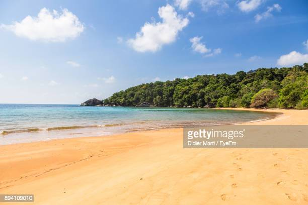 scenic view of beach against sky - didier marti stock photos and pictures