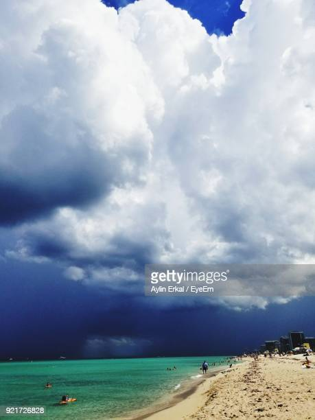 scenic view of beach against sky - haulover beach stock photos and pictures