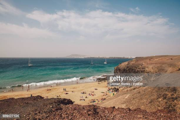 scenic view of beach against sky - bortes stock photos and pictures