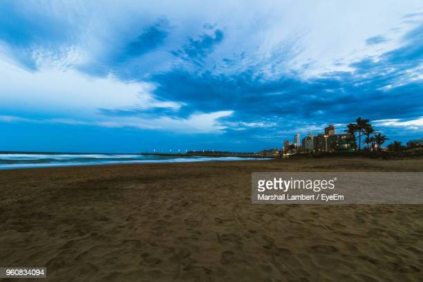 scenic view of beach against sky - durban beach stock photos and pictures
