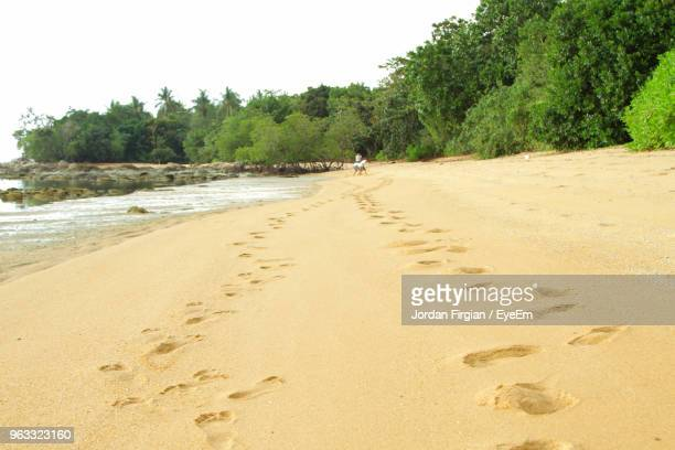 scenic view of beach against sky - west kalimantan stock pictures, royalty-free photos & images