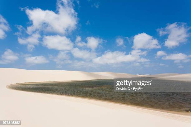 scenic view of beach against sky - barreirinhas stock pictures, royalty-free photos & images