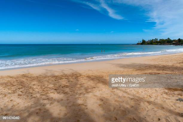 scenic view of beach against sky - josh utley stock pictures, royalty-free photos & images