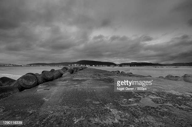 scenic view of beach against sky,aberavon beach,united kingdom,uk - nigel owen stock pictures, royalty-free photos & images