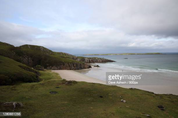 scenic view of beach against sky,a,lairg iv,united kingdom,uk - dave ashwin stock pictures, royalty-free photos & images