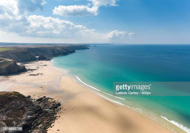 scenic view of beach against sky,porthtowan,truro,united kingdom,uk - drone point of view stock pictures, royalty-free photos & images