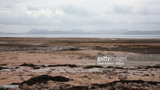 scenic view of beach against sky,unnamed road,strathcarron iv nd,united kingdom,uk - dave ashwin stock pictures, royalty-free photos & images