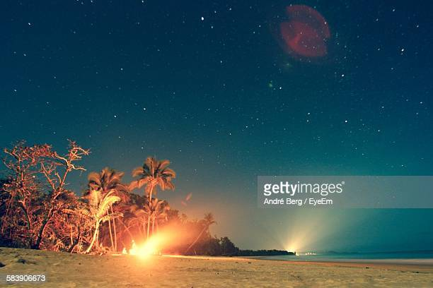 Scenic View Of Beach Against Star Field At Night