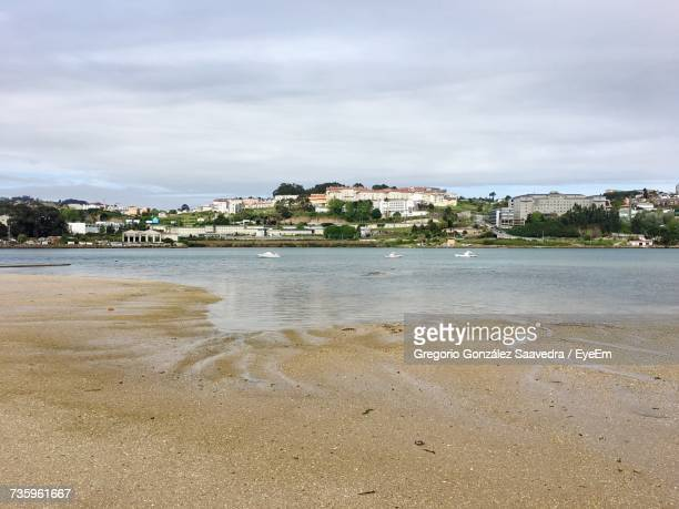 scenic view of beach and city of santa cristina against sky - cristina saavedra photos et images de collection