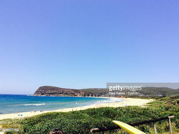 scenic view of beach and sea against clear sky - sahne ストックフォトと画像