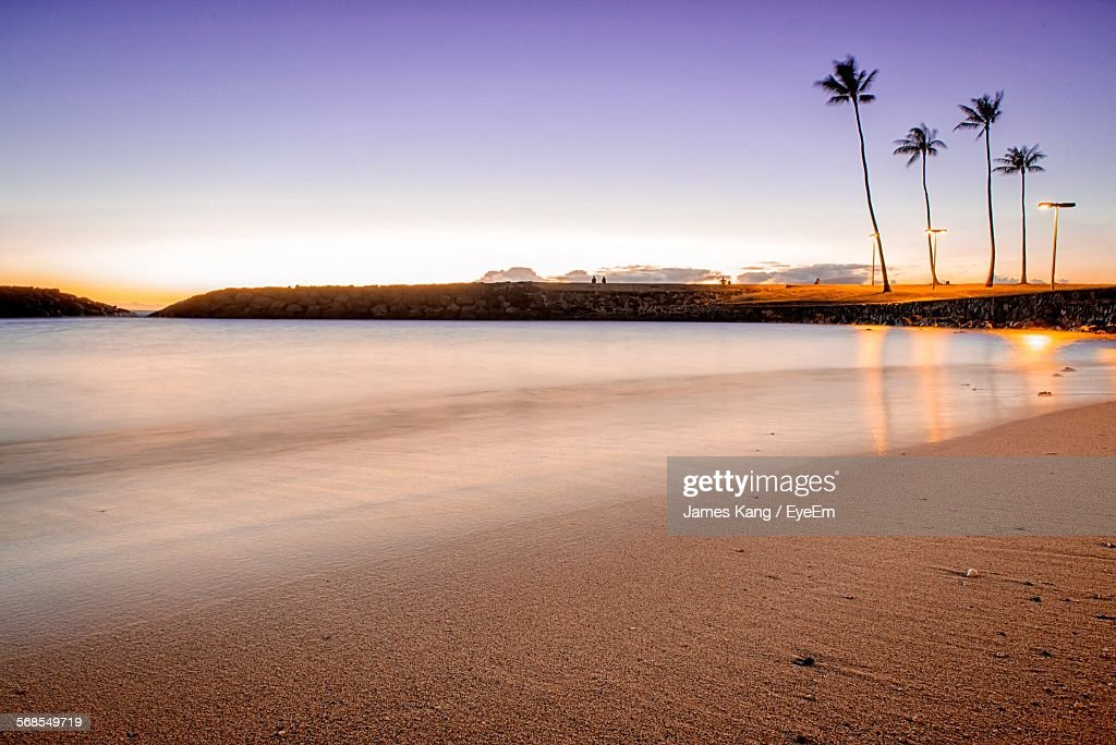 Scenic View Of Beach And Sea Against Sky During Sunset : Stock Photo