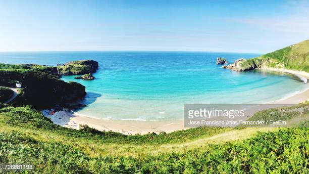 scenic view of beach and sea against sky on sunny day - llanes fotografías e imágenes de stock