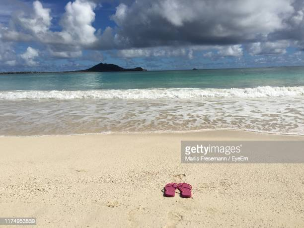 scenic view of beach and sea against sky - kailua stock pictures, royalty-free photos & images