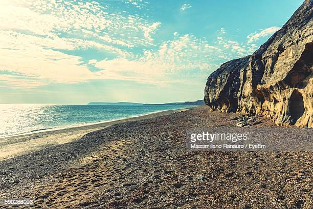 scenic view of beach and sea against sky - massimiliano ranauro stock pictures, royalty-free photos & images