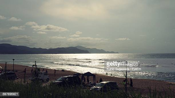 scenic view of beach and sea against sky - hokuriku region stock photos and pictures