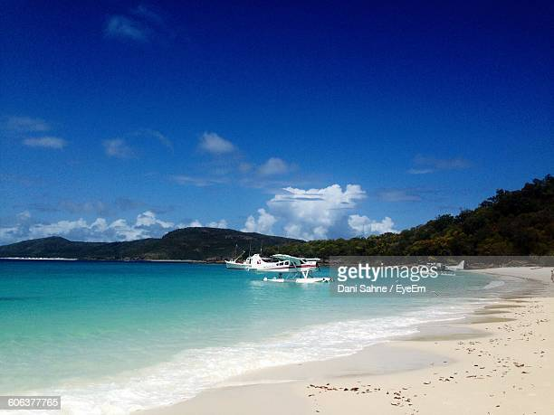 scenic view of beach and sea against sky - sahne ストックフォトと画像
