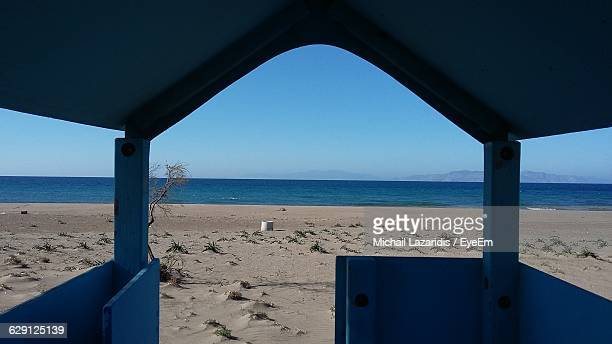 Scenic View Of Beach And Sea Seen Through Structure