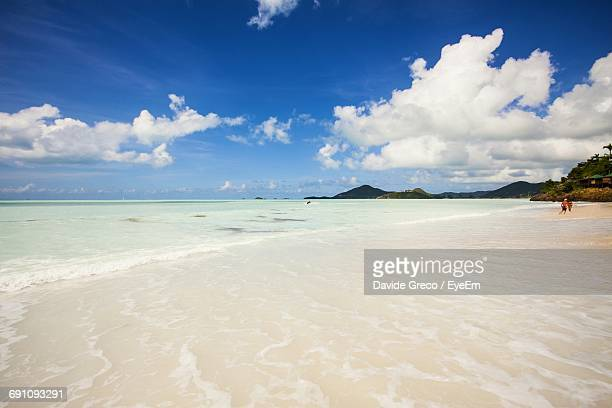 Scenic View Of Beach At Antigua Against Sky