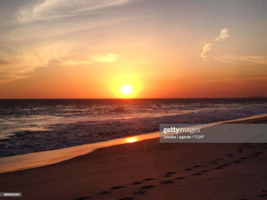Scenic view of beach at sunset in Saquarema : Stock Photo