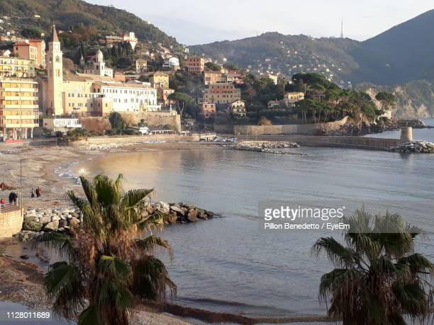 scenic view of beach by buildings against sky - benedetto photos et images de collection