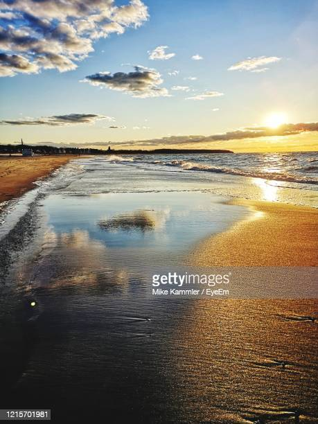 scenic view of beach during sunset - rostock stock pictures, royalty-free photos & images