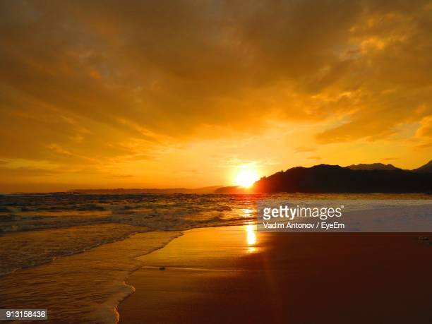 scenic view of beach during sunset - antonov stock pictures, royalty-free photos & images