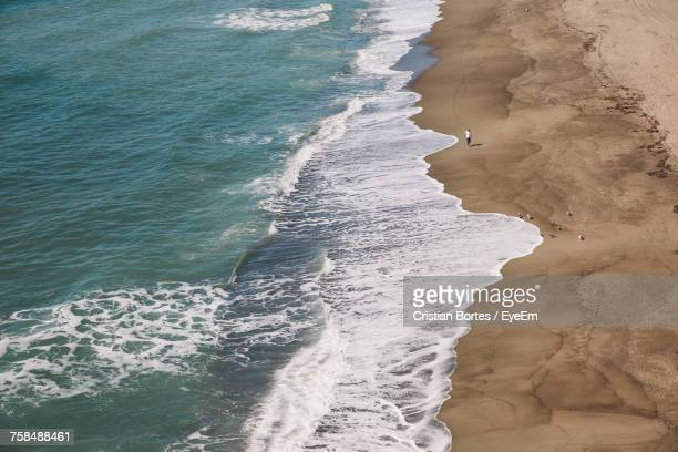 scenic view of beach - bortes stock-fotos und bilder
