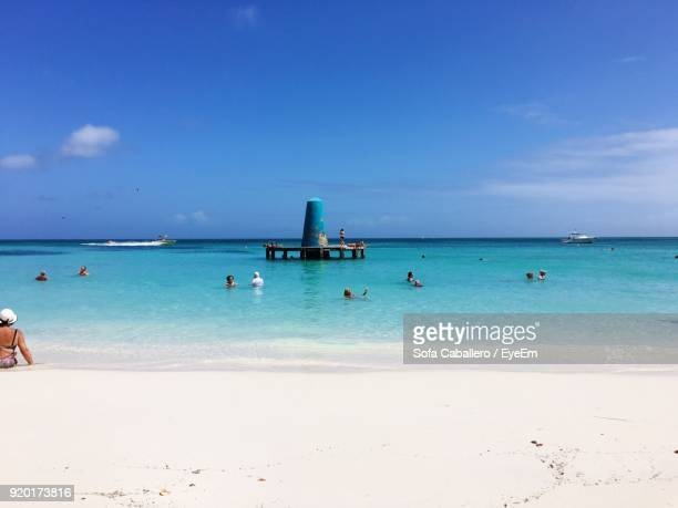 scenic view of beach - oranjestad stockfoto's en -beelden